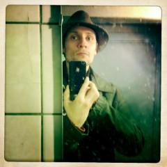 Jonas Villumsen posing wearing a hat.